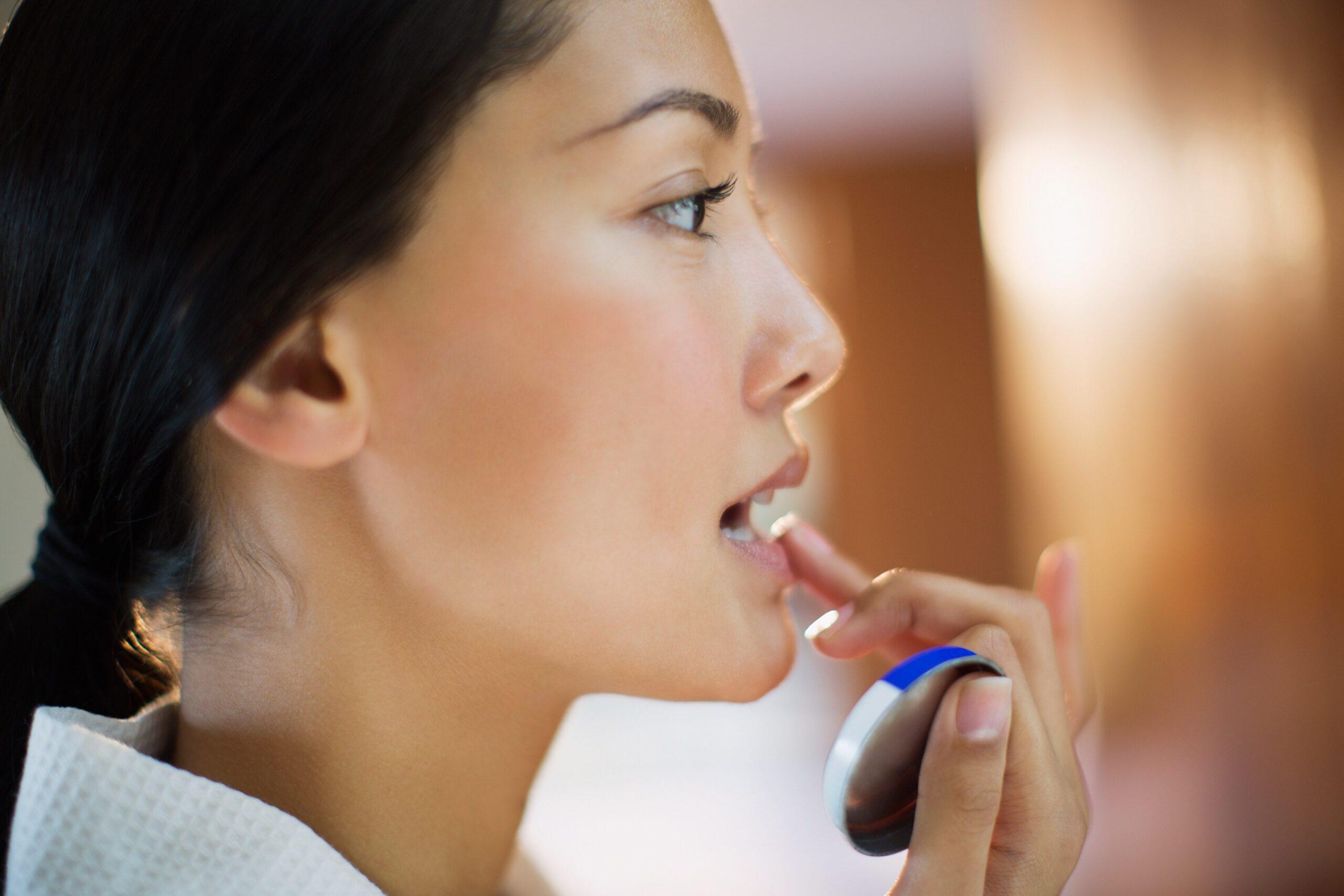 Applying the antifungal cream for lips